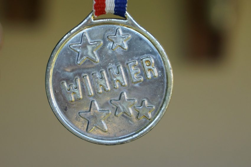 The image is of a gold winner's medal.