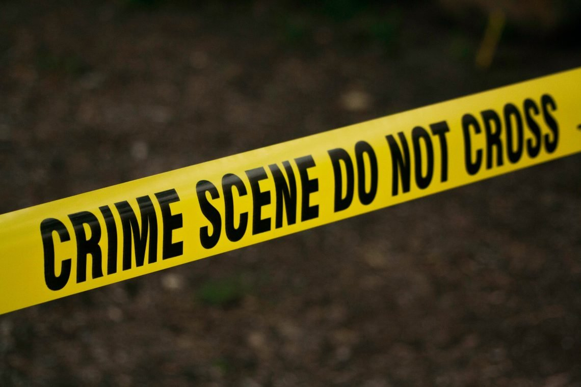 Image shows crime scene tape.